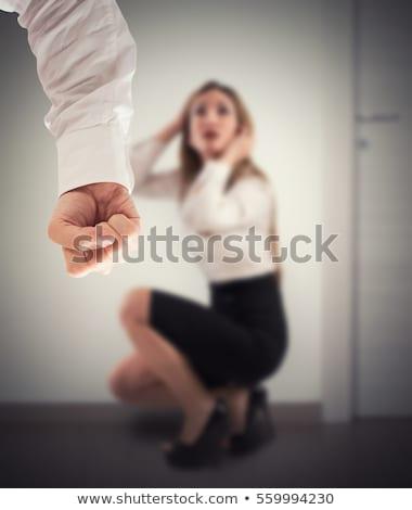 Violento homem ameaçador trabalhador de escritório mulher colega Foto stock © Giulio_Fornasar