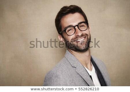 улыбаясь · человека · очки · пальто · красивый · коричневый - Сток-фото © feelphotoart
