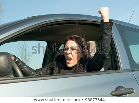 the angry driver shows a fist stock photo © orensila