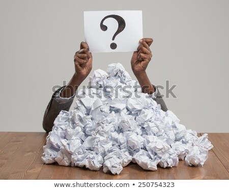 african business woman with crumpled pile of papers stock photo © hasloo