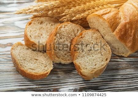 Długo bochenek kłosie pszenicy ciemne mąka Zdjęcia stock © OleksandrO