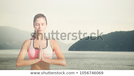 double exposure of a young woman meditating and a peaceful lands Stock photo © nito