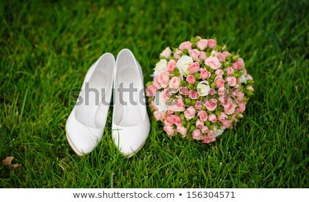 wedding bouquet and shoes lying down on green grass Stock photo © Galyna_Tymonko