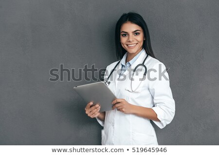 happy female doctor standing against white background stock photo © andreypopov