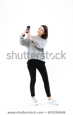 full length picture of a elegant young woman standing stock photo © feedough