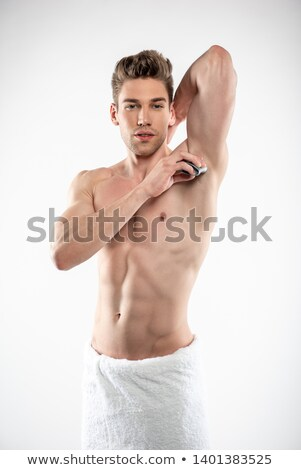 Portrait of a shirtless muscular man wrapped in white towel Stock photo © wavebreak_media