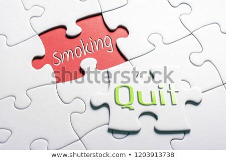 quit   white word on red puzzles stock photo © tashatuvango