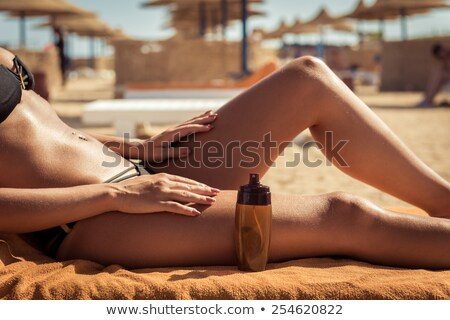 Girl With Suntan Oil Foto stock © nikitabuida