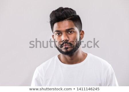 közelkép · jóképű · indiai · fiatalember · portré · másfelé · néz - stock fotó © ziprashantzi