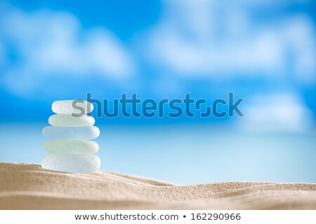 close up of blue sand glass stock photo © ozaiachin