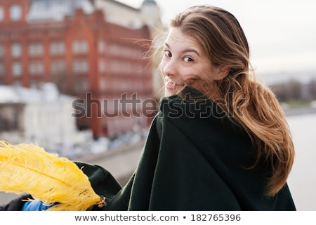 Attractive young woman turning around and looking at you Stock photo © deandrobot