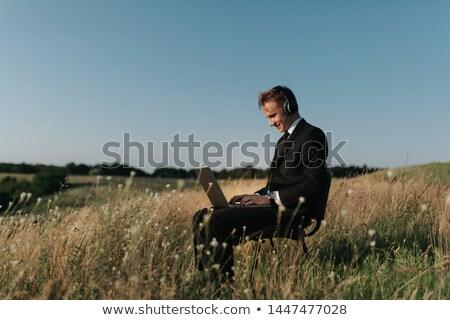 fű · fiatalember · megnyugtató · zöld · fű · néz · kamera - stock fotó © paha_l