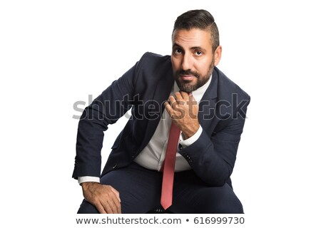 man in suit sitting in studio with hands on his knees Stock photo © feedough