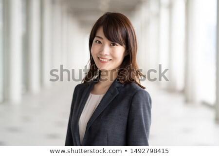 ázsiai · üzletasszony · okostelefon · kommunikáció · nő · iroda - stock fotó © yongtick