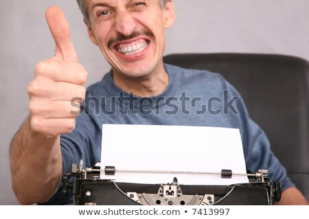 man after the typewriter shows gesture by the finger stock photo © Paha_L