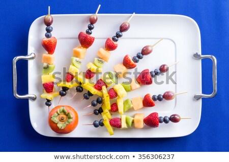 Creative arrangement of colorful fruit kebabs Stock photo © ozgur