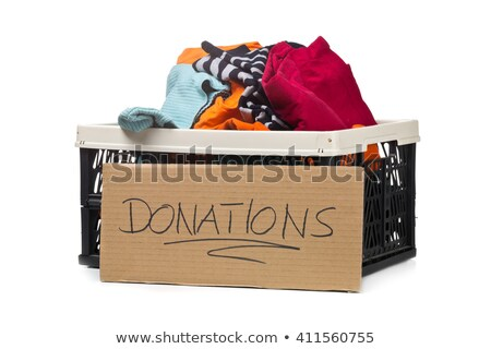 Plastic box with clothing donations and cardboard sign Stock photo © ShawnHempel