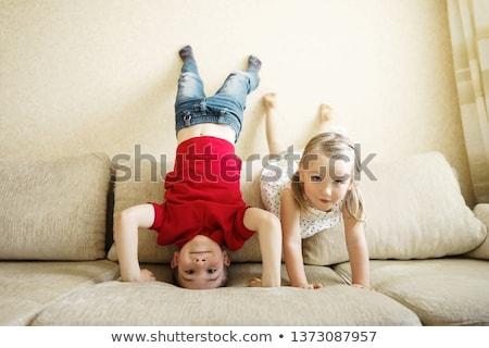 Gelukkig weinig baby jongen ondersteboven lachend Stockfoto © zurijeta