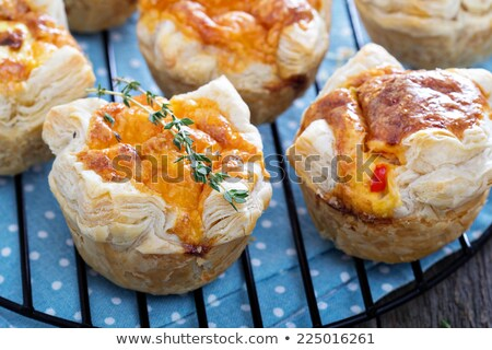 served mini pizza with eggs stock photo © badmanproduction