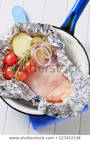 Stock fotó: Raw Chicken Breast And Vegetables In Tinfoil