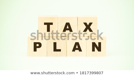 Tax planning time with documents and technology Stock photo © tab62