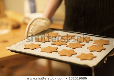 christmas biscuit pastry shapes on baking tray with parchment stock photo © frannyanne