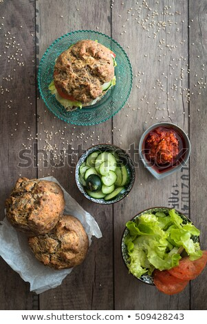 homemade bread, vegetables and sauces for seasoning veggie burger. Top view Stock photo © faustalavagna
