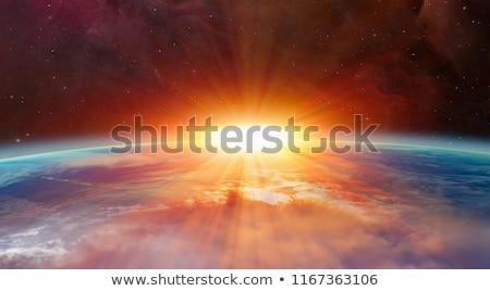 Föld napfelkelte űr föld napja felhők földgömb Stock fotó © -Baks-