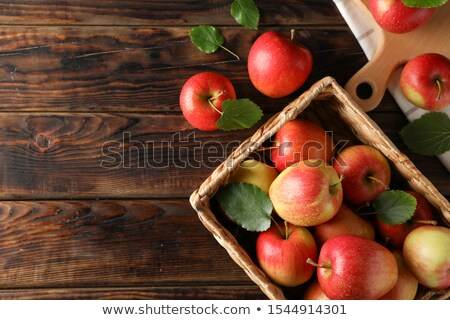 Wicker basket full of red apples Stock photo © orensila