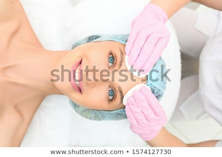 Beautiful young woman perfect face with towel. Skin beauty spa s Stock photo © NikoDzhi