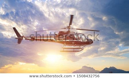 Hélicoptère vol lumière blanche battant nuageux Photo stock © vtls
