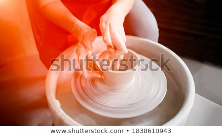 Hands of female potter molding a bowl with hand tool Stock photo © wavebreak_media