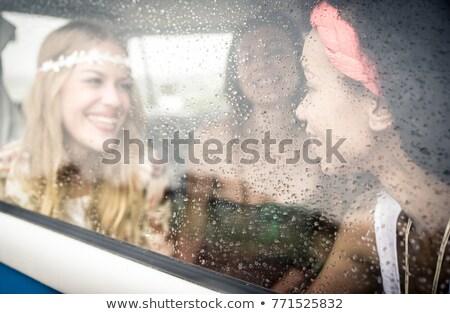 Több nemzetiségű lányok vezetés mikrobusz okostelefon retro Stock fotó © LightFieldStudios