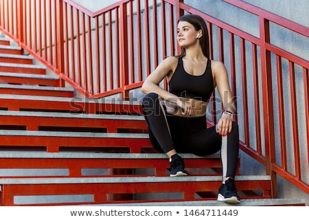 beautiful sport girl in black body sits on the stairs Stock photo © dmitriisimakov