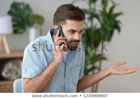 Kellemetlen telefonbeszélgetés aggódó nyugtalan férfi beszél Stock fotó © stevanovicigor