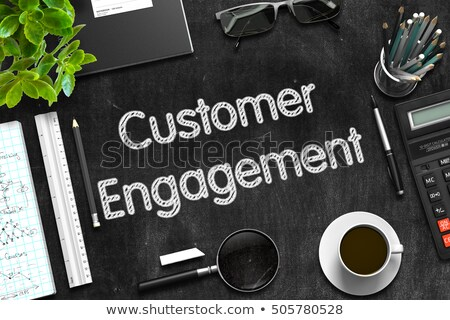 Black Chalkboard with Customer Engagement. 3D Rendering. Stock photo © tashatuvango