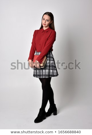 Full length portrait of a pretty young woman in skirt Stock photo © deandrobot