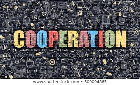 Cooperation in Multicolor. Doodle Design. Stock photo © tashatuvango