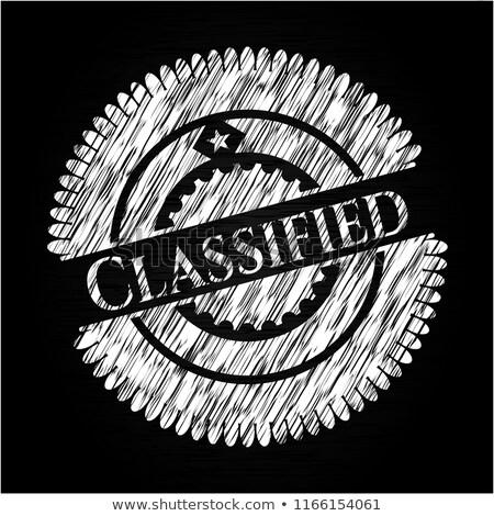 classified information   chalkboard with hand drawn text stock photo © tashatuvango