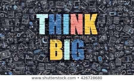 think big on dark brick wall stock photo © tashatuvango
