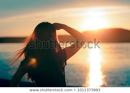 Woman Tourist at the sea looking to horizon Stock photo © Kzenon