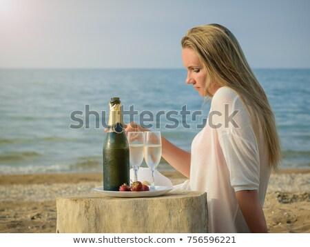 Girl Woman Seashore Drinking Water Shell Stock photo © vilevi