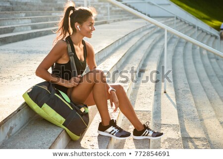 Portret glimlachend vergadering trap buitenshuis zak Stockfoto © deandrobot