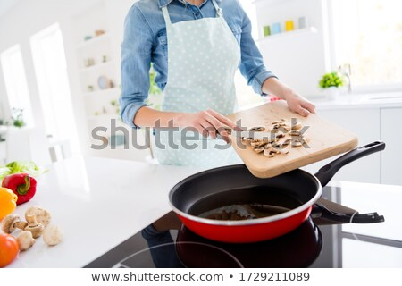 Cropped photo of family eating breakfast in the morning Stock photo © deandrobot