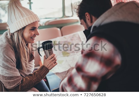 Young couple by camper van looking at map Stock photo © IS2
