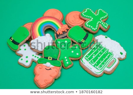 top view of icing cookie in shape of green hat on green, st patricks day concept Stock photo © LightFieldStudios