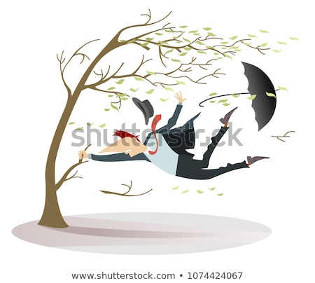 Windy day and man with a hat and umbrella catches a tree isolated Stock photo © tiKkraf69