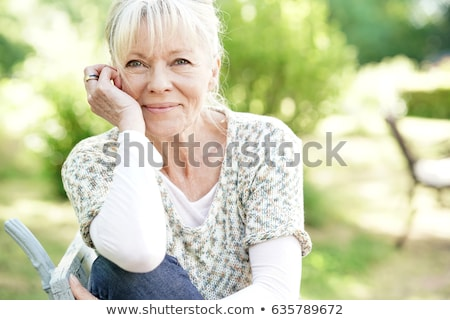 Senior woman in garden smiling Stock photo © IS2