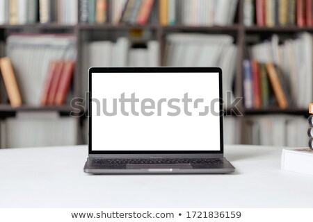 Laptop with with screen against close up of a bookshelf Stock photo © wavebreak_media