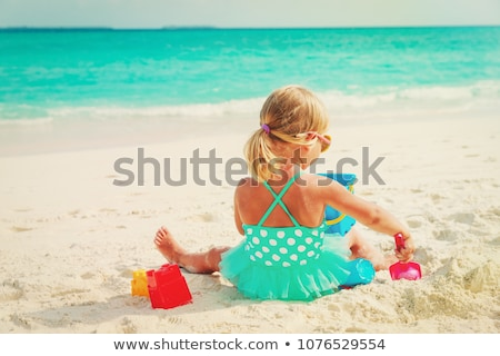 a girl playing at sand stock photo © bluering